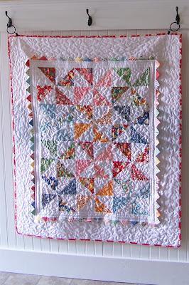 [Pinwheel+quilt+hanging.jpg]