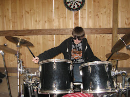 Steven playing his beloved drums
