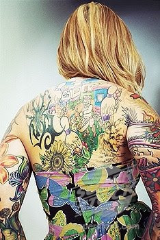 Tattooed woman´s back,beauty of a tattooed