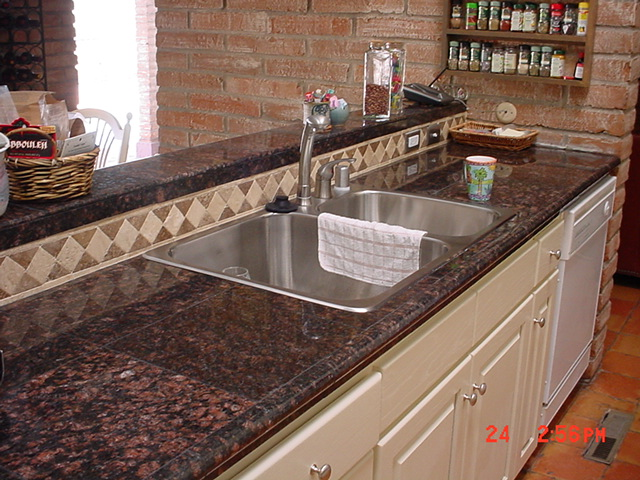 granite tile counter tops. the same look as granite but waaay
