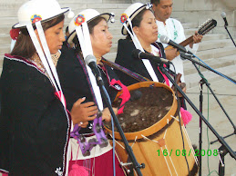 Performers singing in Quechua