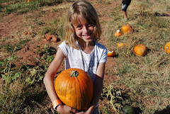 Brooke picks a pumpkin