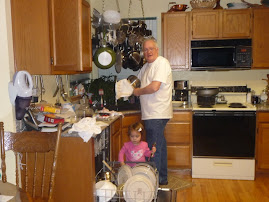 Helping Papa Roger with the dishes!