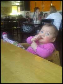 Savannah chillin' in a restaurant in the high chair...
