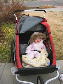 Loving her new stroller (it was a chilly day for a walk!)