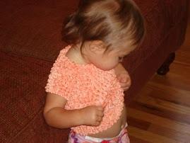 Feeling her groovy new shirt that Grandma Linda gave her