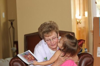 Savannah giving Grandma kisses for her gift (donation to a children's charity)