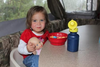 Savannah having fun feeding her own baby in the camper