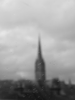 blurry view of Salisbury Cathedral spire in distance