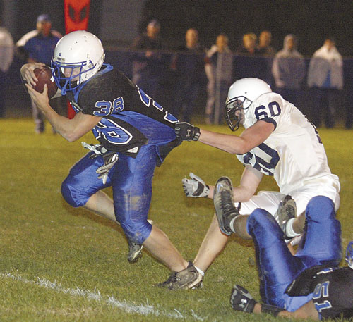 Rensselaer's Todd DeLuke tries to pull him to the ground during a game at