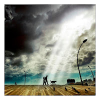 couple walking hand in hand peigions light rays clouds