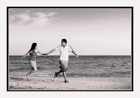 loving couples swept away black and white beach
