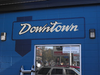 Downtown auto sign shop hand painted classic retro style Victoria Vancouver island Canada