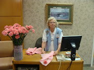 Ernestine Stewart, St.Mary's Volunteer, handed out pink carnations to each woman.