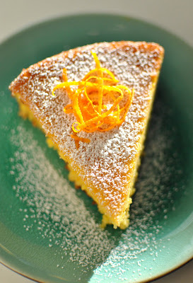 Serve with pure icing sugar and decorate with orange rind