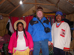 Me with President Willie &  Wife Maria, their hut, Uros floating reed Islands, Lake Titicaca