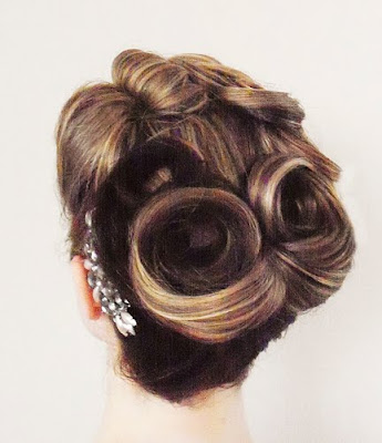 victory rolls hairstyle. victory rolls hairstyle. is 3