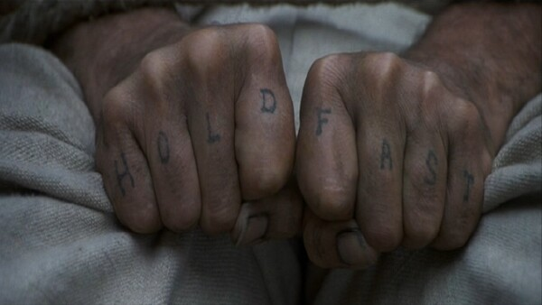 Joe Plaice's tattooed hands in the film, Master and