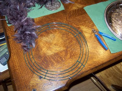 Just cut lengths of wire and wired the feather boa to the wreath