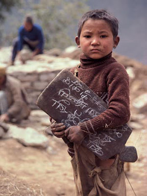 Sherpa child with writing tablet.