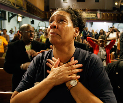Vonda Jackson reacts in Baltimore after hearing that Barack Obama had been elected President of the United States.