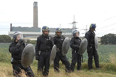 Police defending the existing Kingsnorth power station during the 2008 Climate Camp protests.