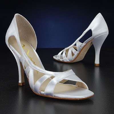 Chinese Laundry offers a sassy ivory sandal adorned with a classic bow and a