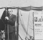"George Jeffreys outside the Big Tent with his Welsh ""Corgi"" dog at the sea-front at  Hove,1949"
