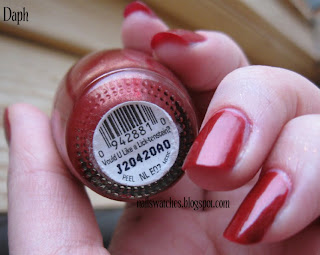 opi vould you like a lick-tenstein? red nail polish shimmer gold nailswatches