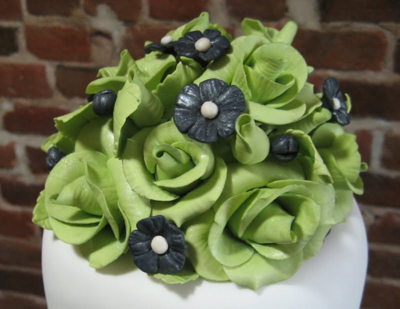 Chartreuse green roses and black were used to echo their lovely invitations