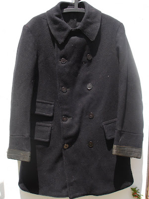 This is a British early 1950s pea coat style jacket.