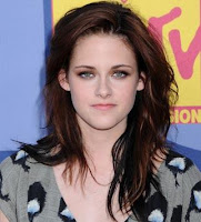 Her locks might be dark, but Kristens hair  contained a myriad of shades ...
