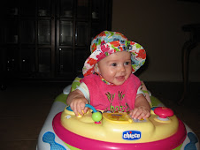 In her walker with her new hat