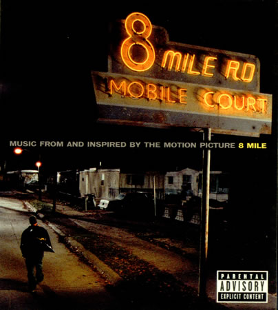 8 mile In eminem's first movie, 8 mile, the white rap star is hooded in about five  different ways at once: there's a nike knit cap on his head and,.