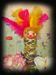 feather head doll.