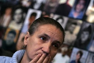 Esrefa Alic, a survivor of 1995 Srebrenica massacre, reacts to television coverage from the The International Court of Justice in an office in Tuzla February 26, 2007.