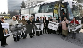 A bus carrying some 50 relatives of Srebrenica victims prepare to leave Sarajevo in Bosnia early Saturday, Feb. 24, 2007 for the Netherlands to attend Monday's verdict by the International Court of Justice in a genocide case against Serbia and Montenegro in the Hague. Bosnia-Herzegovina filed the case in 1993 — the first time a state, rather than individuals, had been charged with genocide. In case it wins, it hopes later to seek compensation for the loss of life and property during the 1992-95 war, when an estimated 200,000 people were killed and when entire Muslim Bosniak towns and villages were devastated