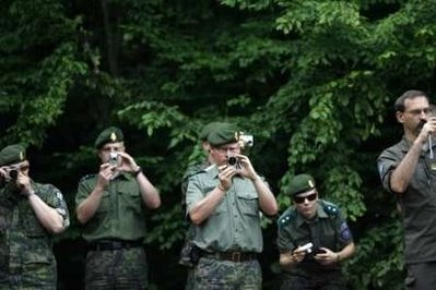 PHOTO CAPTION #12: EUFOR peacekeepers in Bosnia take pictures of forensic experts from the International Commission for Missing Persons (ICMP) work in a ...