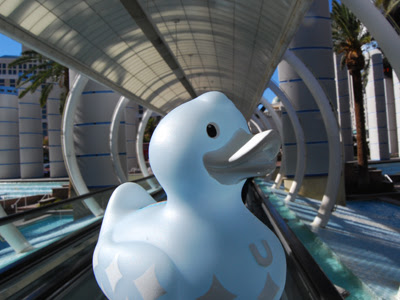 this rubber duck photo is of a cool luxury duck standing at the teh futuristic tube at ballys