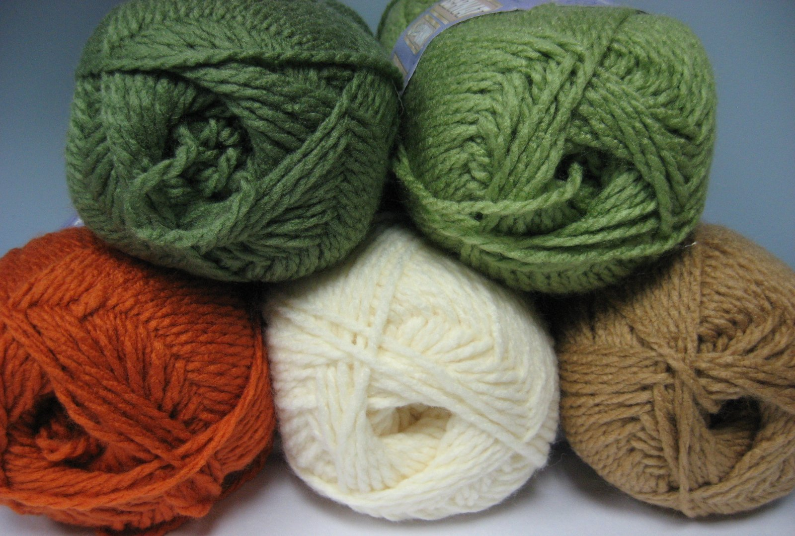 Crocheting Pronunciation : All except the pumpkin colored yarn these are the colors that were