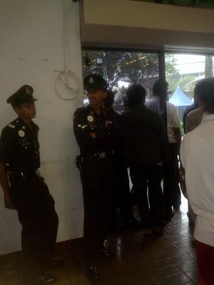 policemen with pistols inside Pasar Seni