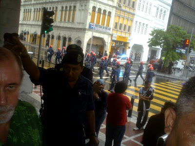 Riot Squad behind marchers at Standard Chartered Bank, Medan Pasar