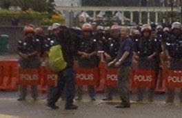 Al Jazeera TV crew in action in front of Dataran Merdeka