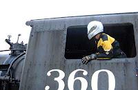 Brad plays locomotive engineer. But safely.