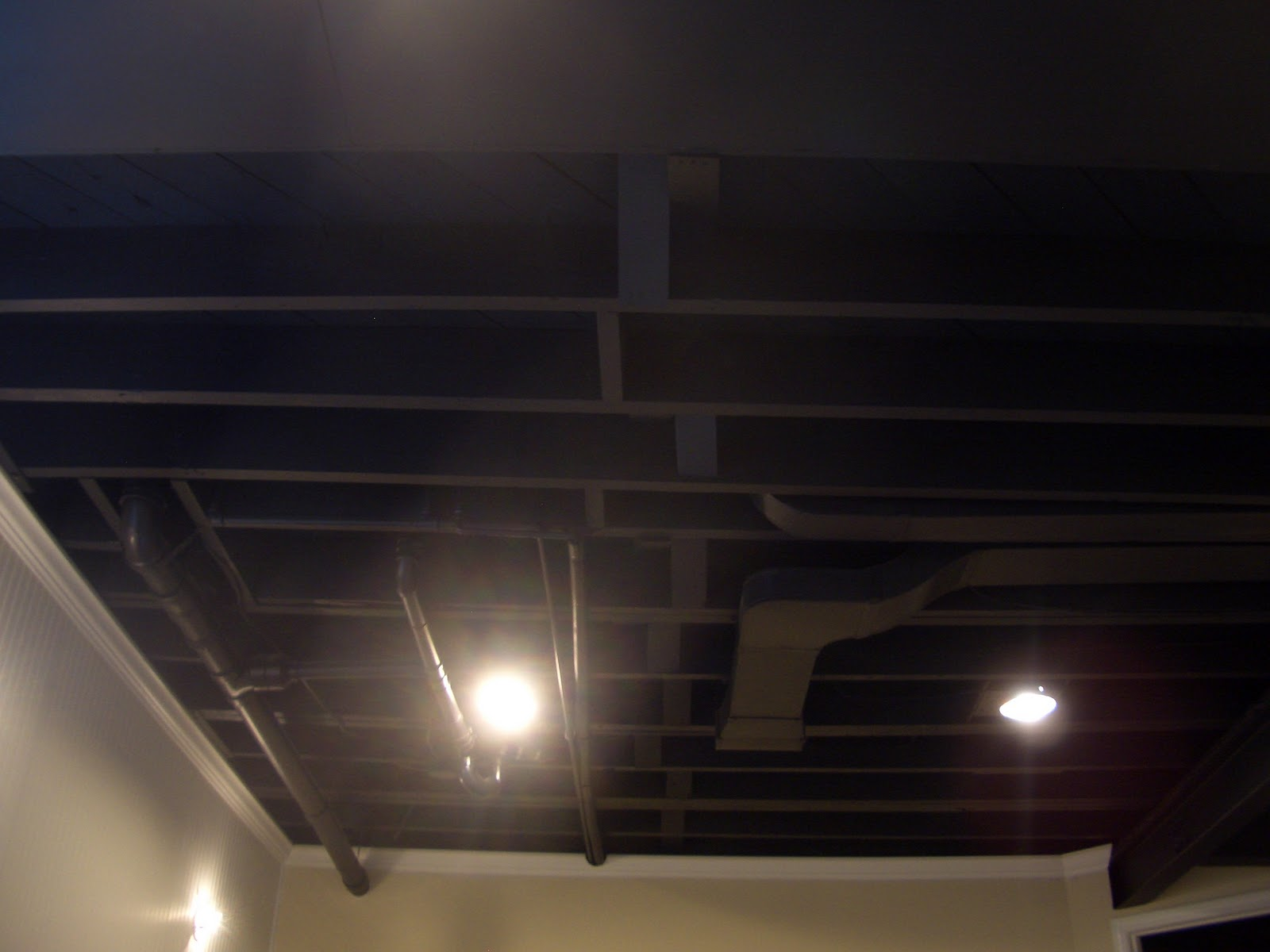 Cool home creations finishing basement black ceiling for Painting on ceiling