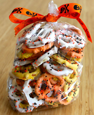 http://www.bakedperfection.com/2010/10/candy-corn-themed-chocolate-covered.html