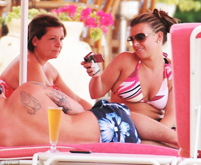Coleen Rooney continues her daily bikini parade in Barbados with a pink two ...