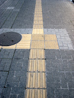 A strip to assist blind people, on a sidewalk in Himeji