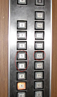 Japanese elevator buttons, including 13 but skipping 4