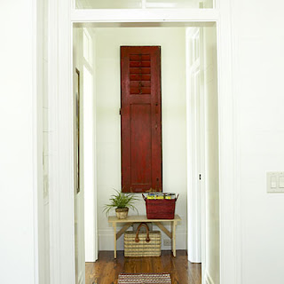 ohmigosh design blog 2010 southern living offered a great tip here if you have a fuse box or other eye sore it can easily be hidden an architectural piece such as this
